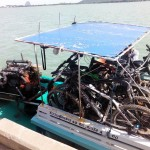 loading the long tail boat with mountain bikes